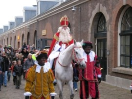 Sinterklaas arriving on horse back