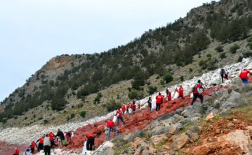 Many volunteers working on the project to clean the National Flag