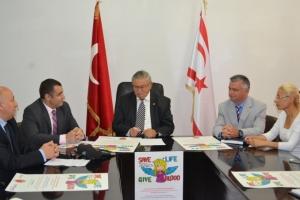 Health Minister, Dr. Ertuğrul Hasipoğlu accepts the posters