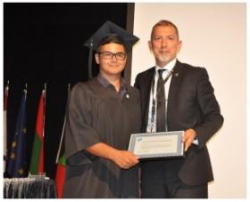 Chancellor Serhat Akpinar makes an award