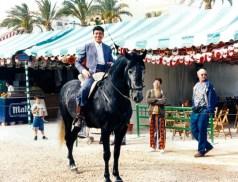 Spanish man riding a horse