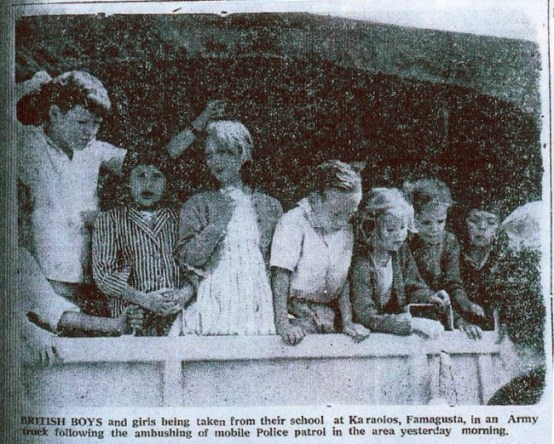 British school children being escorted out of Karaolas school to safety by British Army trucks