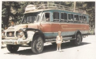here was a regimental bus similar to the one in the photo attached, painted army green. that would have been used to bring the children to schoo