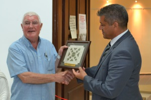 he Mayor, Ismail Arter presents a plaque of appreciation to Richard