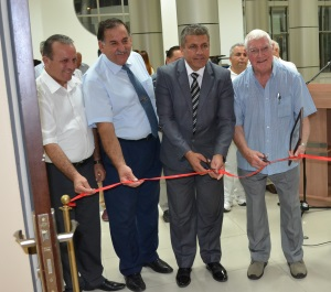 Cutting the ribbon, the official opening