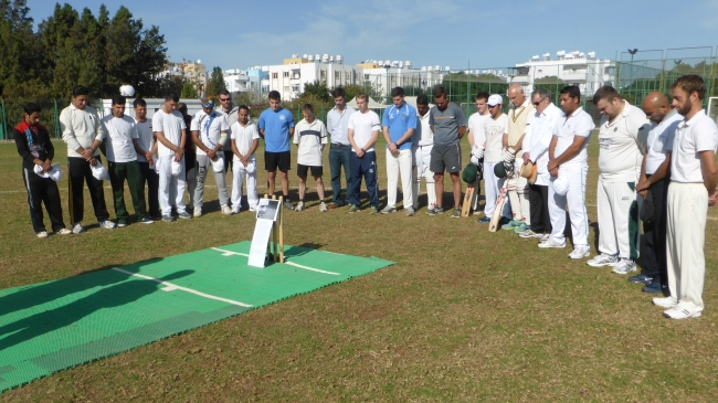 A minute's silence in memory of Phillip Hughes before the TRNC v Nicosia cricket match