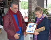 Carole King presents a certificate to Shayna Beach Club