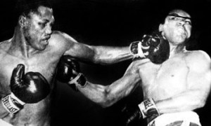 Frazier catches Ali with his famous left hook