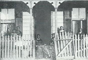 Biddy Mason (Grandma Mason) (seated left in the doorway) visiting friends in Los Angeles