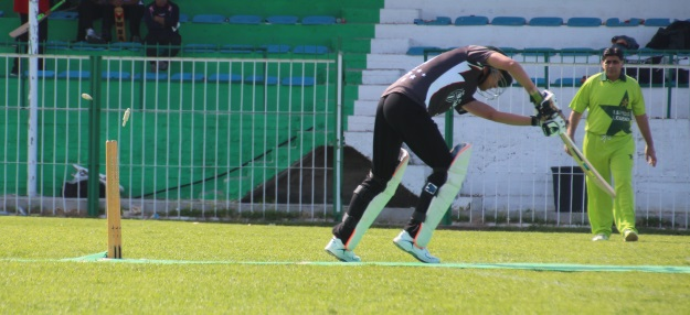 NEU's Khan being bowled by Lefkoşa Legend's Saad