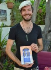 """Jay Wadams with John Guthrie's book """"A bell in Bellapais"""""""