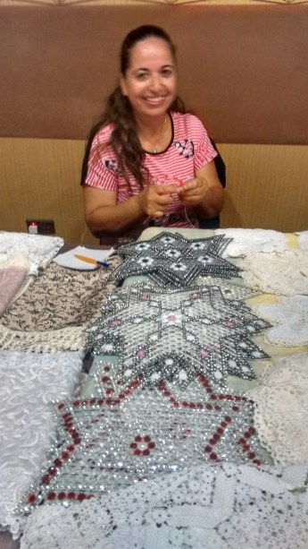 Fatma with her crocheted goods