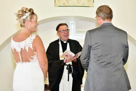 FR MARTIN ADMINISTERS THE VOWS – AND EVERYONE SEEMS TO BE ENJOYING IT!