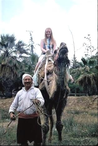Deveci Hūseyin giving a tourist a camel ride. photo courtesy of Aysh Nafi