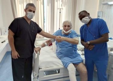 Dr Ramadan and Emmanuel help me celebrate a successful operation