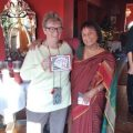 Suzi Moir with award presented by Lalitha Scott