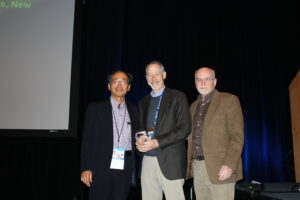 "Session Chairs Weiping Jiang (L) and John O'Shea (R), awarding the 1st ICIS-BIOLEGEND BILL PAUL AWARD to Richard Locksley, UCSF, after his lecture, ""New pathways in type 2 immunity"" on Tuesday, 18 October, 2016."