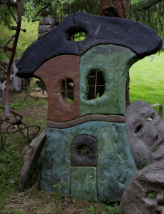 a whimsical concrete cottage by artist, inventor and concrete finisher John Czegledi