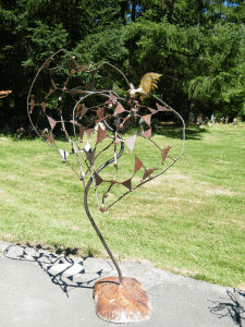 a patina metal abstract art piece by John Czegledi artist, inventor and craftsman from Courtenay BC