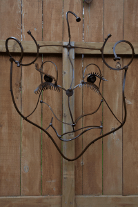 a patina metal abstract face made from scrap metal by artist and designer John Czegledi from Courtenay BC