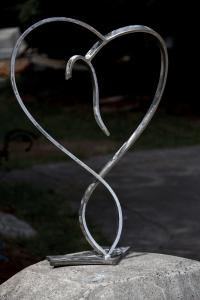 a stainless metal heart sculpture by Courtenay based artist and designer John Czegledi