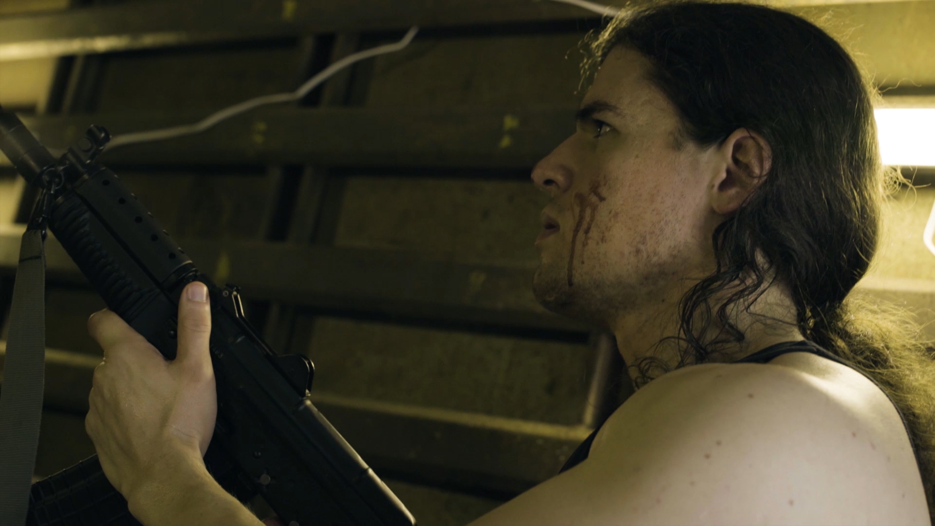 From the sci-fi short film Fringe Territory: Salvage Mission One. Quinton listens, with rifle.