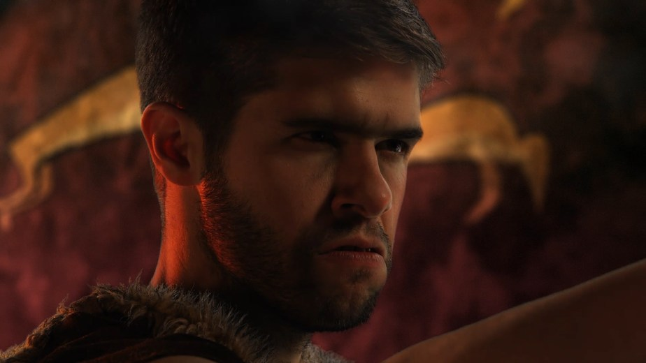 Visual effects composite of a caveman in a fire-lit cave.