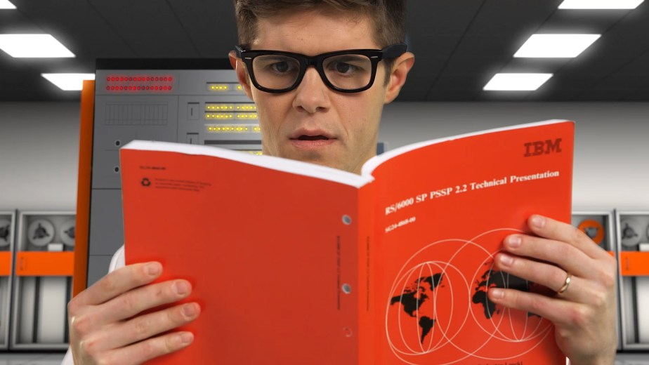 Visual effects composite of a man reading a Redbook in an IBM System 360 datacenter.
