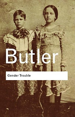 A book cover depicting two children standing side by side. It is not clear if the children are boys or girls,. Both are wearing dresses. The image is overlaid with the words Butler and Gender Trouble.