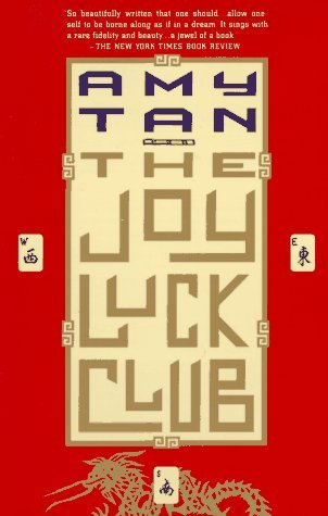 Red borders with Mahjong tiles to west, east, and south surround yellow centre with the author's name written in blue and the book title in gold.