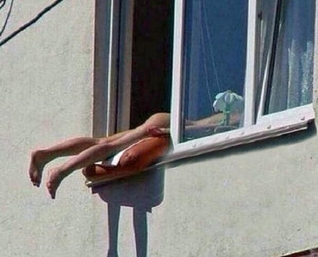 Austrian Nude Sunbather Causes Car PileUp After Hanging Bottom Out of Window