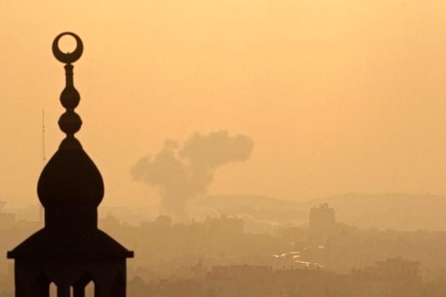 Smoke rises following an Israeli air strike in Gaza