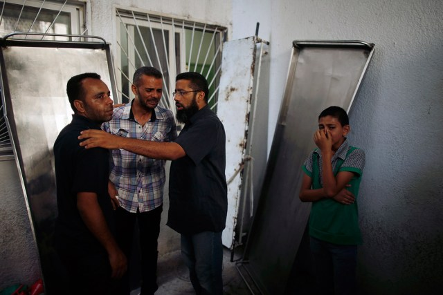 The relatives of an Islamic Jihad militant from the Abu Nada family, killed in an Israeli air strike, mourn at a hospital morgue in the northern Gaza Strip
