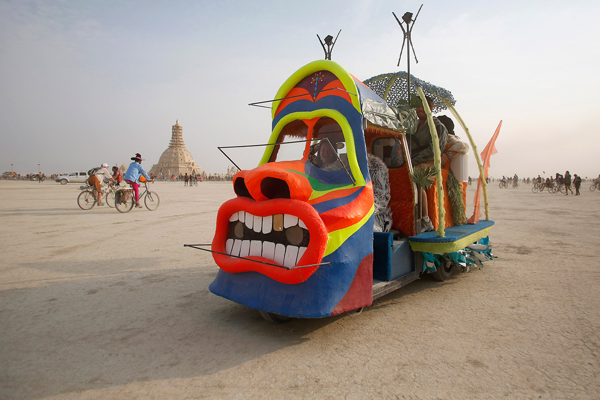 A mutant vehicle drives across the Playa. Most mutant vehicles are heavily modified road vehicles, but some are made from scratch