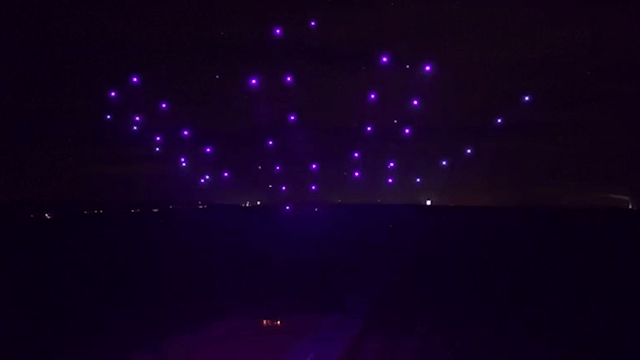 100 drones take to the sky in synchronised performance