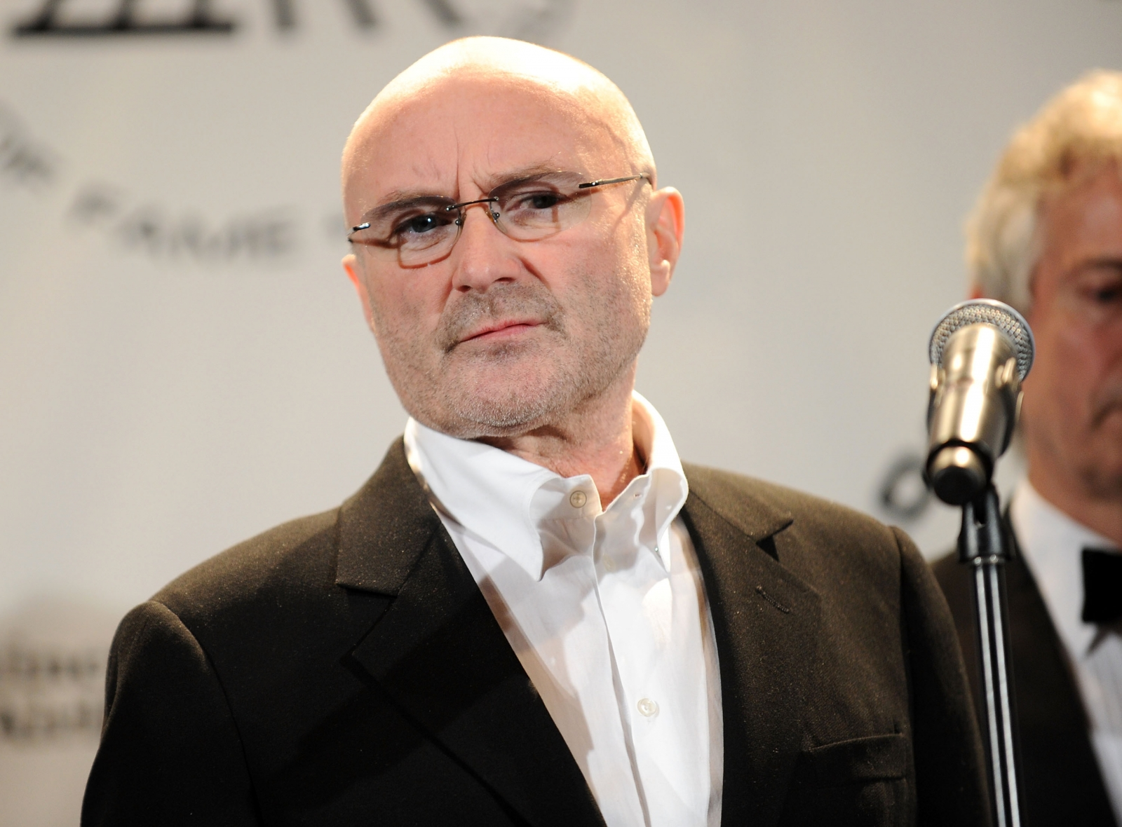 cane with chair hanging hammock indoors phil collins rushed to hospital after 'nasty' fall, cancels london royal albert hall shows