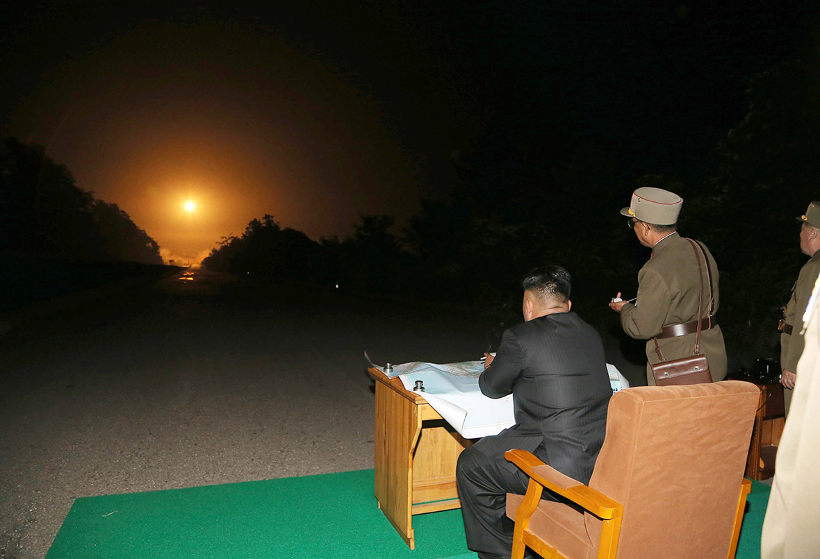 child desk and chair toddler rocking recliner kim jong-un watching the rocket take off looks like a pink floyd album cover : pics