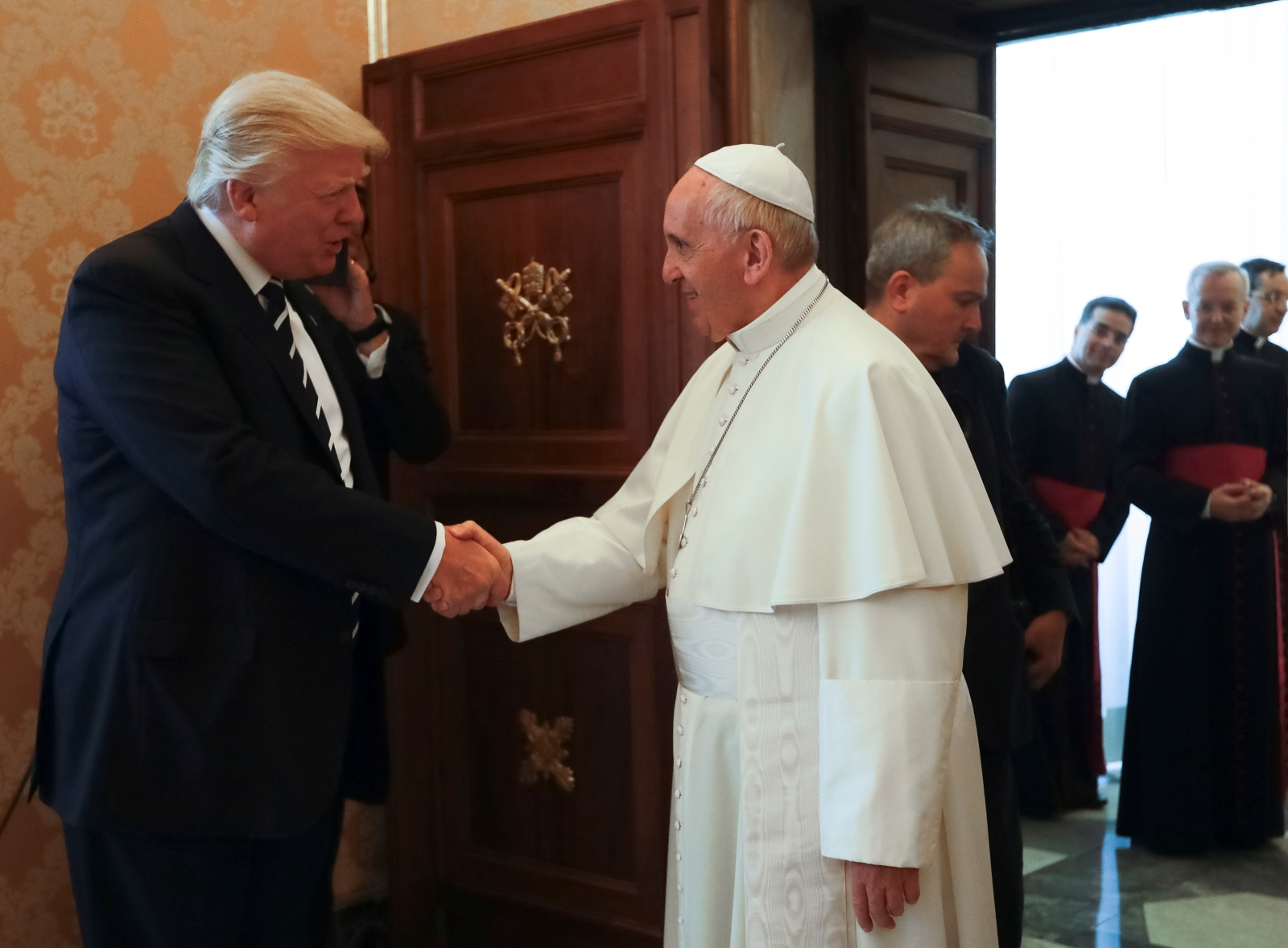 Which issues do Donald Trump and Pope Francis disagree on