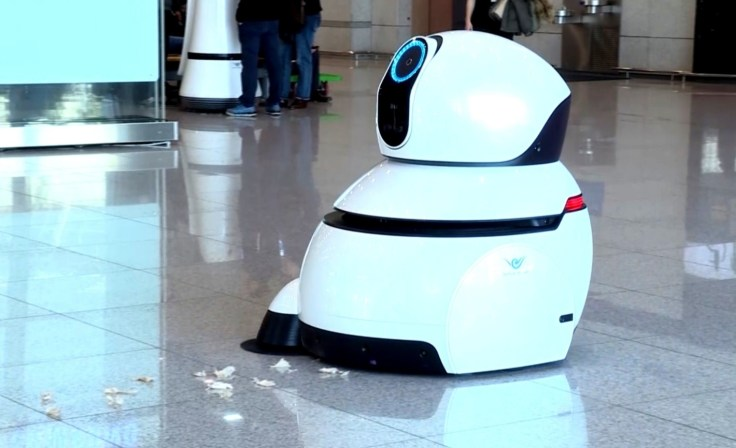 These LG airport robots take you to the gate and pick up