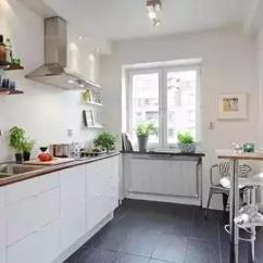 Kitchen Table Nook Space Saver 有这样子的厨房 谁都愿意下厨了 将黑色移到墙上和台面上 让原木色的地板来装饰 这样的颠倒设计也很具特色 同样的一字型橱柜加上小餐桌的设计 从图中可以看出数量众多的收纳 这应该是最让人羡慕的