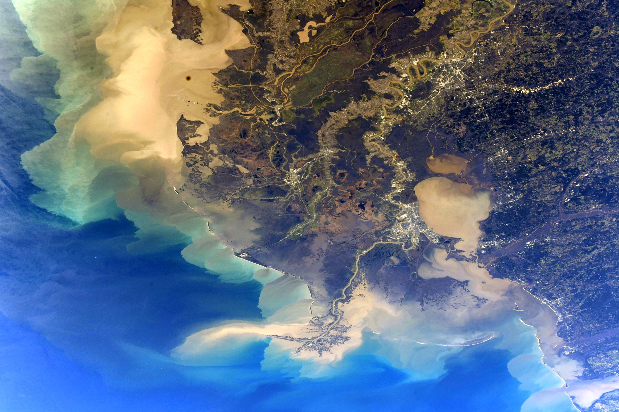 """Like somebody spilled their watercolors"": Spectacular photo of Louisiana captured by NASA astronaut from ISS"