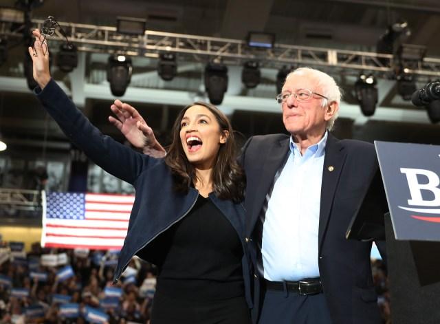 AOC and Bernie Sanders stand together