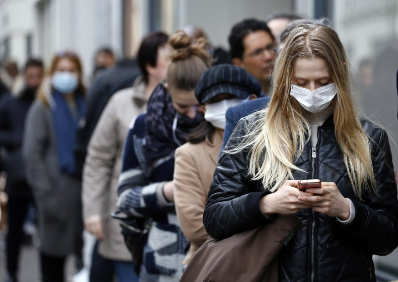 Line of people wearing face masks