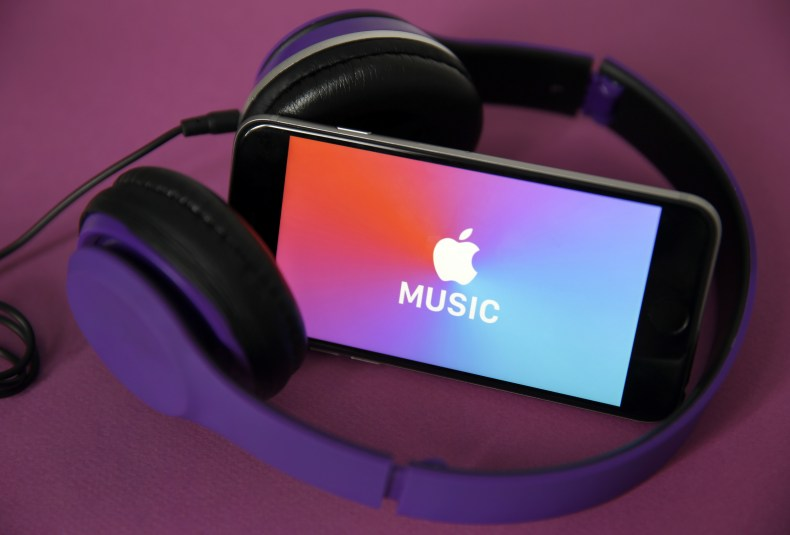 Apple Music on an iPhone with headphones