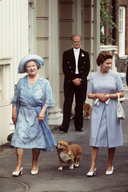 Queen Elizabeth and Queen Mother Walk Dog