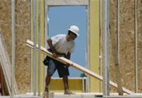 Reuters - A worker constructs a new home in Geneva, Illinois, June 23, 2009. REUTERS/Jeff Haynes ...
