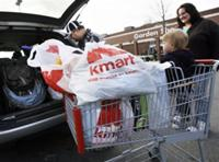 AP - FILE - In this Nov. 19, 2009 file photo, shoppers prepare to load their car with purchases from ...