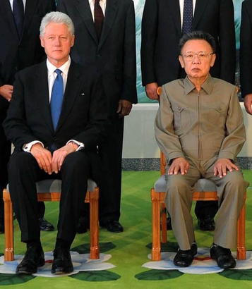 In this Aug. 4, 2009 file photo released by Korean Central News Agency via Korea News Service in Tokyo, former U.S. President Bill Clinton, seated lef