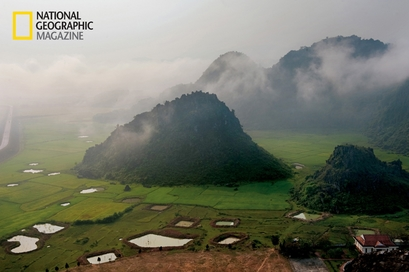 Mist sweeps past the hills of Phong Nha-Ke Bang ...