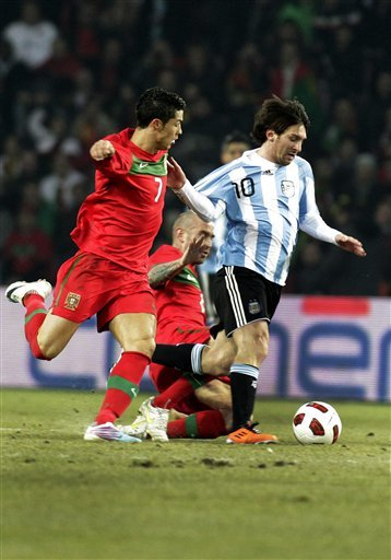 Argentina's Lionel Messi, Center, Fights For The Ball With Portugal's Players Cristiano Ronaldo, Left And Raul Meireles,